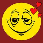 emoticono amarillo con cara de enamorado y corazones alrededor